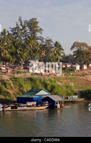 A scenic view of a community living in poverty, located above the shore of the Mekong River in Cambodia. - Stock Photo