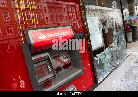 Vandalised bank ATM and smashed window broken by anti capitalists protesters, London, UK - Stock Photo