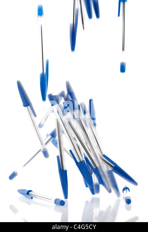 Pile of falling blue ballpoint pens - Stock Photo