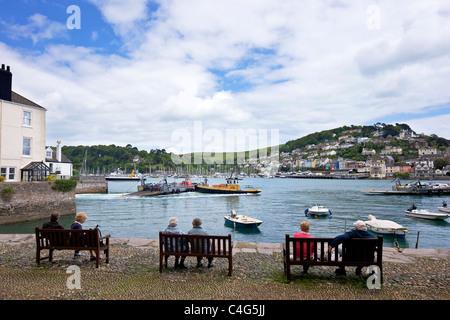 Tourists watch lower ferry crossing River Dart estuary Bayard's Cove Dartmouth South Devon England UK GB Great Britain - Stock Photo