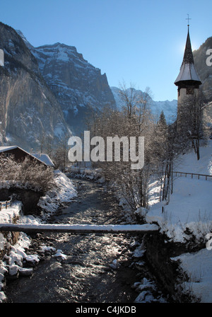 Lauterbrunnen church and river in winter, Switzerland - Stock Photo