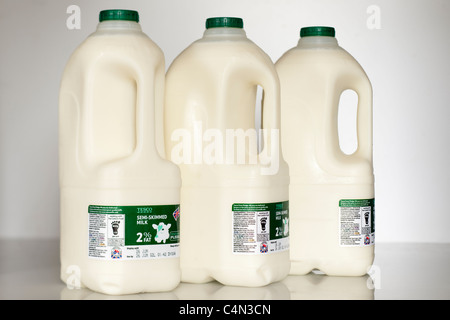 Three plastic four pint or 2.272 litre bottles of Tesco semi skimmed milk - Stock Photo