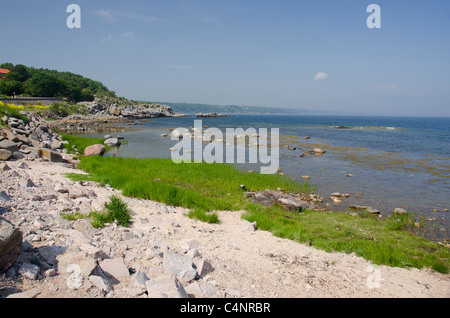 Denmark, Island of Bornholm, Gudhjem. Coastline at Gudhjem located along the shores of the Baltic Sea. - Stock Photo