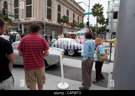 A crowd and car scene at the 2011 Rodeo Drive Concours D'elegance - Stock Photo