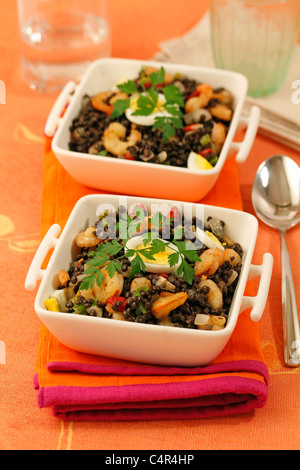 Lentils with prawns. Recipe available. - Stock Photo
