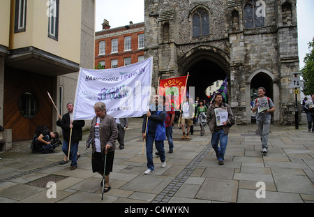Trade Unionists protesting against public service cuts enter the historic city of Winchester via the Westgate - Stock Photo