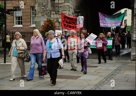 Trade Unionists protesting against public service cuts enter the historic city of Winchester via the Westgate Arch - Stock Photo