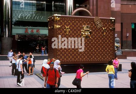 Oversized Louis Vuitton suitcase Ngee Ann City Shopping Mall Singapore - Stock Photo