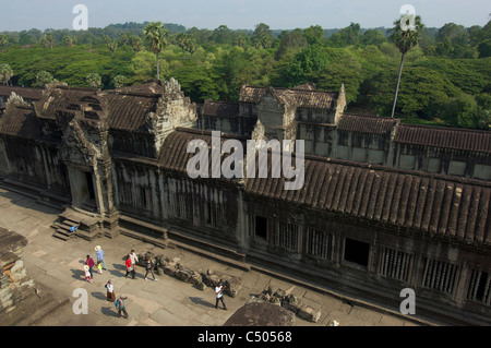 Local tourists in the inner courtyard of Angkor Wat, Siem Reap, Cambodia - Stock Photo