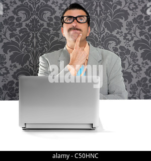 genius nerd silly glasses computer thinking gesture problem solution wallpaper background - Stock Photo