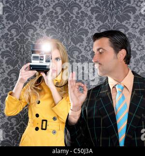 geek tacky mustache man reporter fashion girl photo shoot retro wallpaper - Stock Photo