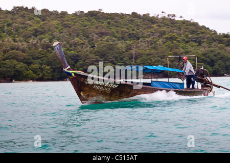 The easiest way to get from one beach on Phi Phi Island to another is by longtail boat taxi. Phi Phi islands in - Stock Photo