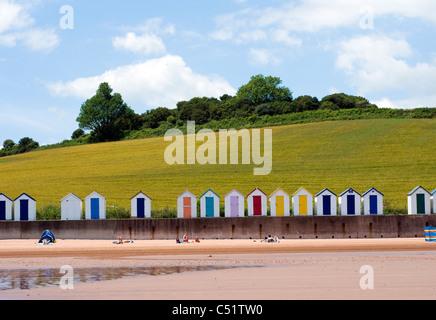 Broadsands beach,Beachhuts and green fields, BOATS, BLUE, SEA, SKY, SEASIDE, SCENE, SEASHORE, BATHERS, COASTAL, - Stock Photo