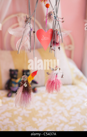 Close-up of wind chime decorated in a bedroom - Stock Photo