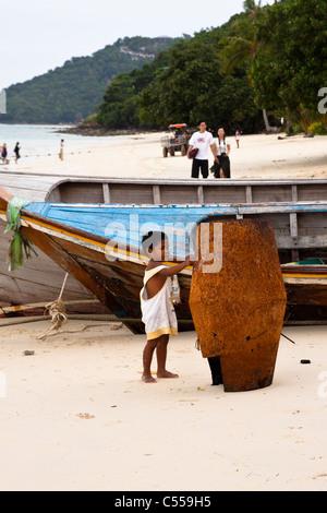 Local boy play on the beach. Sea Gypsy Village in Phi Phi island - Stock Photo