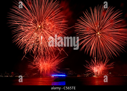 Red fireworks explode during the annual Macy's show on the  Hudson River in New York City July 4th 2011. © Craig - Stock Photo