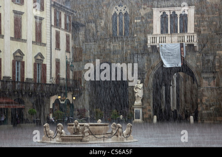 Piazza Vecchia in Bergamo under heavy rain - Stock Photo