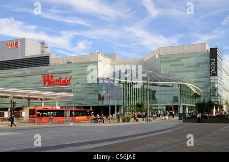 Westfield shopping centre and part of adjoining 'White City' bus station including Vue cinema and Next clothing - Stock Photo