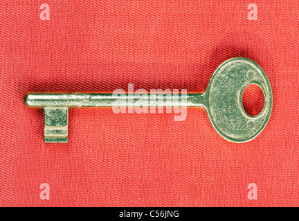 old golden key to the door isolated on white background - Stock Photo