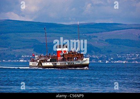 The World's last ocean going paddle steamer Waverley approaches Largs Pier in the Firth of Clyde Scotland on a sunny - Stock Photo