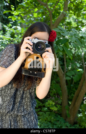 young woman taking a photo - Stock Photo