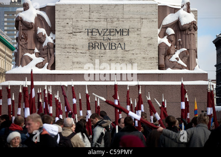 RIGA, LATVIA, MARCH 16, 2010: Latvian flags at Freedom monument. Commemoration of the Latvian Waffen SS unit or - Stock Photo