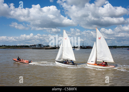 Sailors under tuition on the river Deben, Bawdsey Ferry, looking towards Felixstowe Ferry, Suffolk, UK - Stock Photo