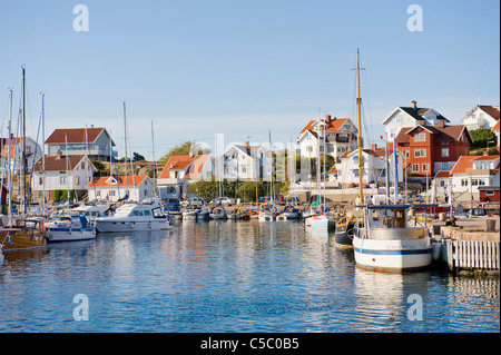 Mollösund fishing village against clear sky with sea in the foreground - Stock Photo