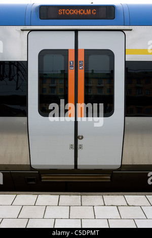 Close-up of closed train doors at the Stockholm railway station platform - Stock Photo