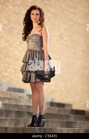 Full length portrait of a beautiful teenage girl in white ball dress - Stock Photo