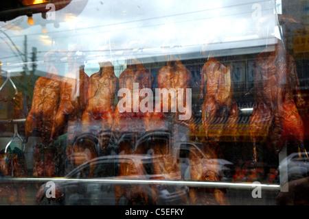 chinese roast ducks hanging in a restaurant window in chinatown toronto ontario canada - Stock Photo