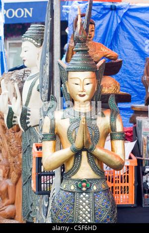 A  Wooden Thai Buddha Praying - Stock Photo