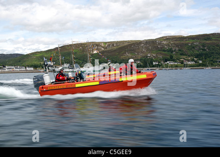British Red Cross Ambulance fast rescue craft in action with crew aboard - Stock Photo