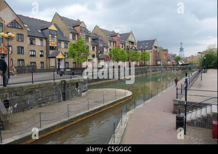 Houses and waterway at Discovery Walk, which is located in the heart of Wapping, Tower Hamlets, London, England, - Stock Photo