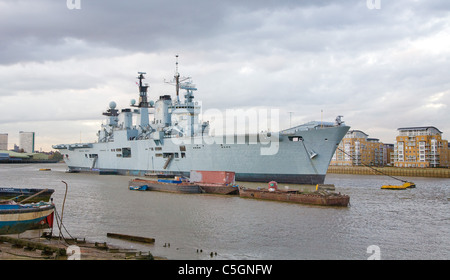 HMS Ark Royal R07 aircraft carrier and former flagship of the Royal Navy at anchor in the River Thames at Greenwich - Stock Photo