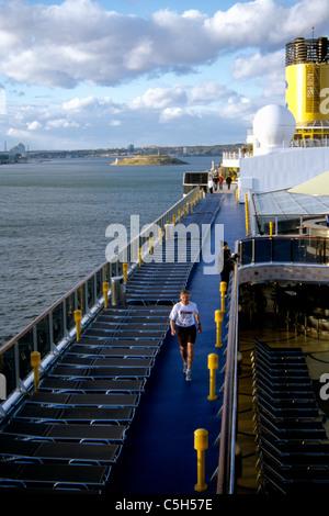 man walks for exercise early morning on costa cruise ship Atlantica on Canada Cruise - Stock Photo