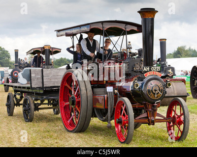 Traction engine towing trailer at Woodcote Vintage Steam Rally, Woodcote, Reading, Berkshire, England - Stock Photo
