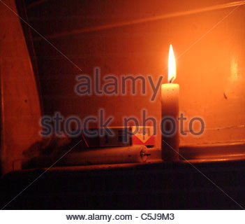 Camping equipment used by explorer Kypros in Africa - candle inside the vehicle - Morocco - Stock Photo