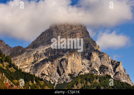 Low early morning cloud on Sassongher mountain seen from the village of Corvara in the Dolomites, northern Italy. - Stock Photo