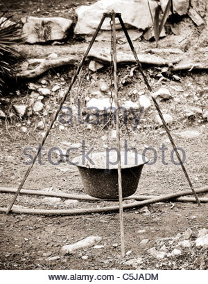 Camping equipment used by explorer Kypros in Africa - cooking tripod - Stock Photo