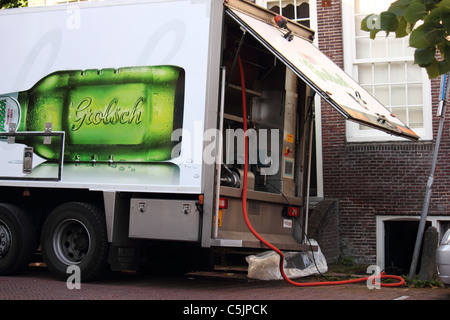 A Grolsch beer truck delivering beer in The Netherlands - Stock Photo