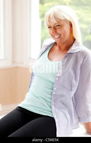 Happy woman sitting - Stock Photo