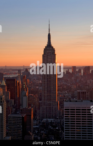View of city and Empire State Building from the Rockerfeller centre in the early evening light, New York, USA - Stock Photo