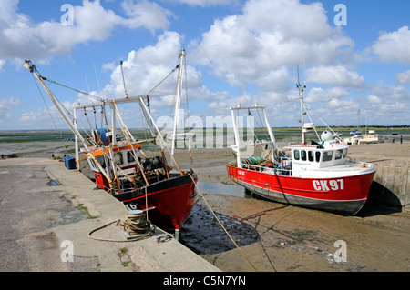 Fishing boats landscape at low tide on the River Thames Estuary mud at Bell Wharf at Old Leigh on Sea Essex England - Stock Photo