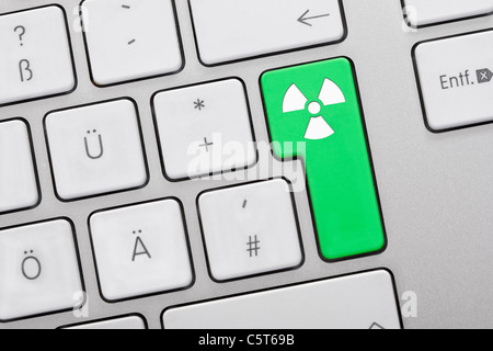 Close up of computer keys with atom symbol on green key - Stock Photo