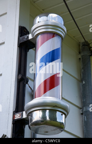 traditional barber shop pole sign in Lynchburg , tennessee , usa - Stock Photo