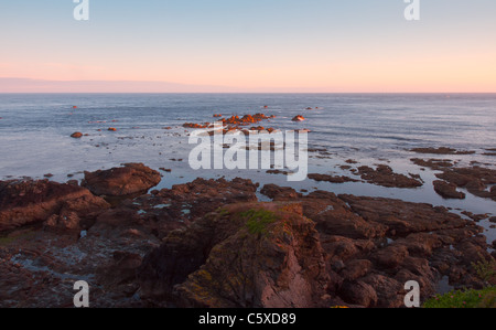 Sunset at Polpeor Island, Lizard Point - Stock Photo