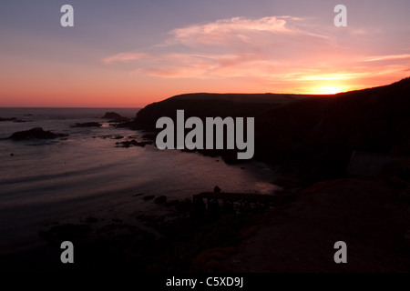 Sunset at Polpeor Cove, Lizard Point - Stock Photo