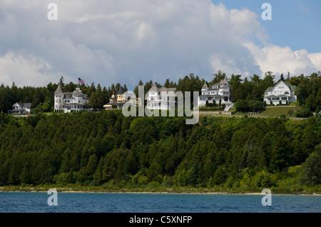 Row of Victorian historic houses on Mackinac Island, Michigan - Stock Photo