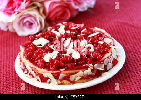 Delicious cheesecake with redcurrant and almond - Stock Photo